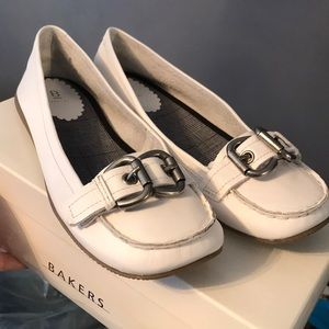 Brand new white flats with silver buckle.